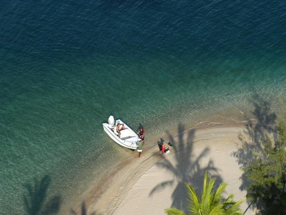 Manda Bay - boat on beach