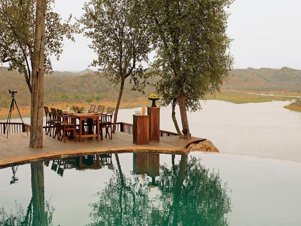 Singita Pamushana Lodge - meal beside lake