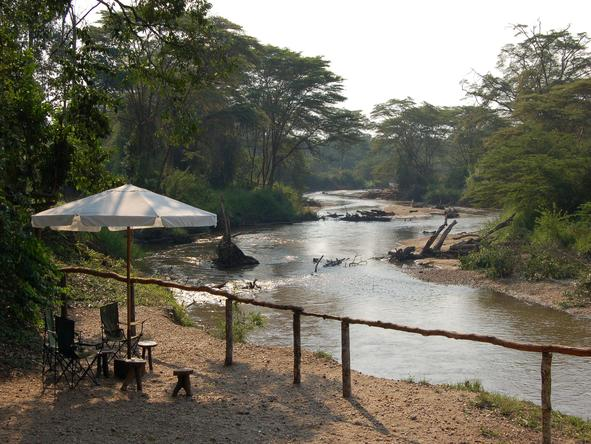 Ishasha Wilderness Camp - umbrella on river bank