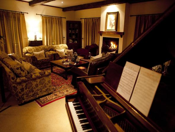 The Manor at Ngorongoro - lounge + piano