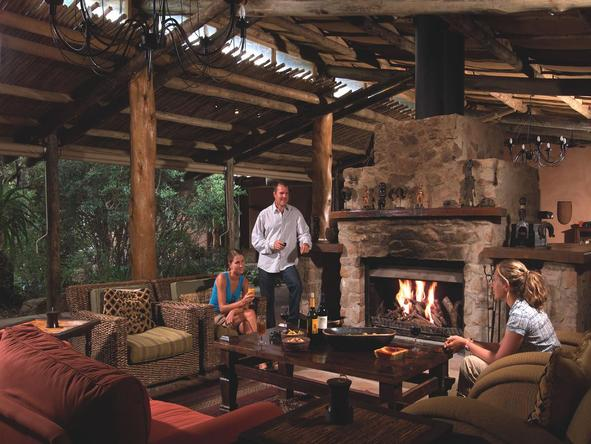 Ukhozi Lodge - lounge with fireplace