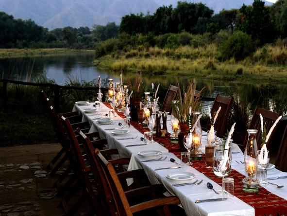 Chongwe River Camp - dinner on riverbank