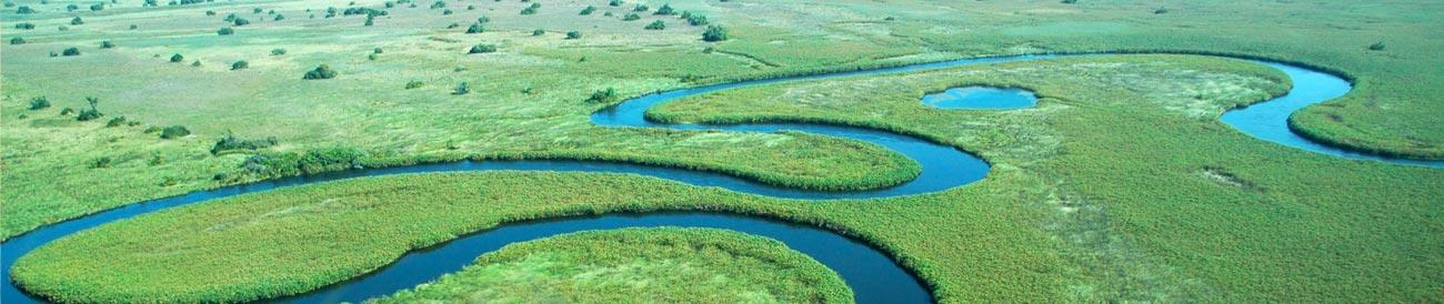 Okavango Delta - explore the twisting waterways and islands of the Delta by 4X4, boat &amp; on foot.