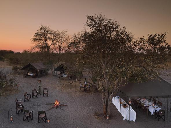 Sandibe Okavango Safari Lodge - boma dinner with fire