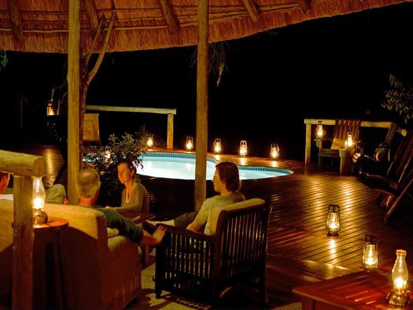 Kwando Lagoon Camp - lounge at night