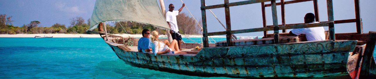 Zanzibar Honeymoon - white-sailed dhows &amp; a sapphire sea are just part of your romantic Indian Ocean adventure.