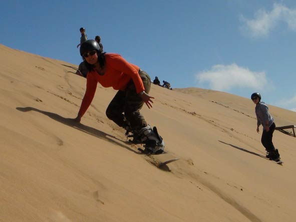 Sharlene Swart - sandboarding Namibia's biggest dunes
