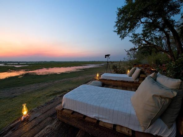 Savour an incredible Botswana sunset at one of the luxury camps in the Okavango Delta.
