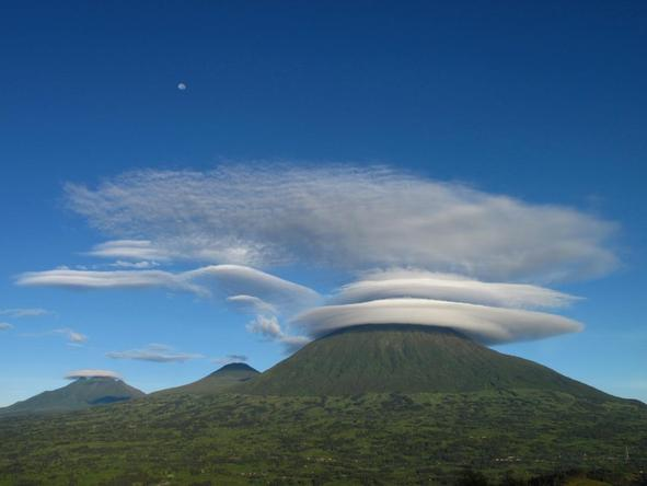 Circular clouds move in incredible formations over the Volcanoes mountain range.