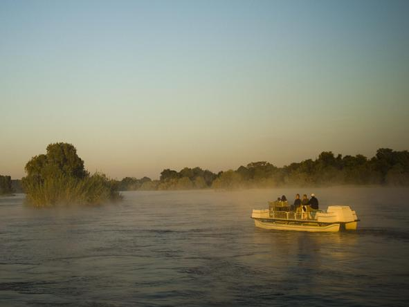 Discover the quieter side of the Zambezi, with a boat cruise upstream of Victoria Falls.