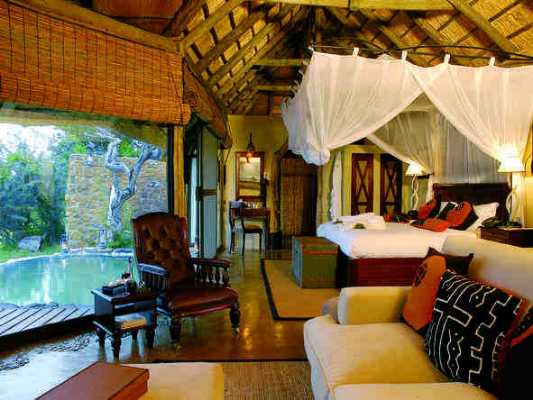 Leopard Hills Private Game Reserve - bedroom and private deck