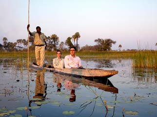 Botswana Seasonal Guide - poling through the delta in a mokoro