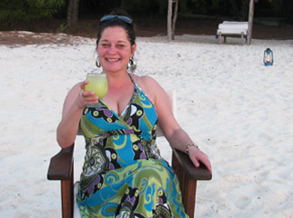 East vs Southern Africa Safaris - Lauren enjoying a cocktail in Zanzibar