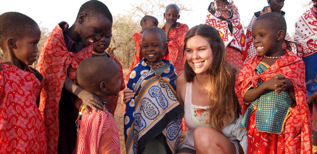 Our Latest Travels Kenya & Tanzania - Catherine making friends with the local Maasai children.