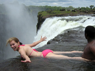 Victoria Falls Activities - Experience the thrill of the Devil's Pool on the lip of the Falls