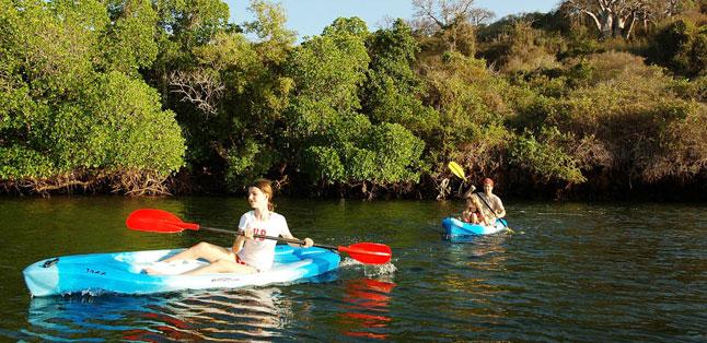 Teens in Africa - A young teenager kayaking at Kiwayu on Lamu Island, Kenya
