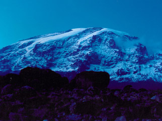 The Big Escape - the ice blue snow cap of Mount Kilimanjaro