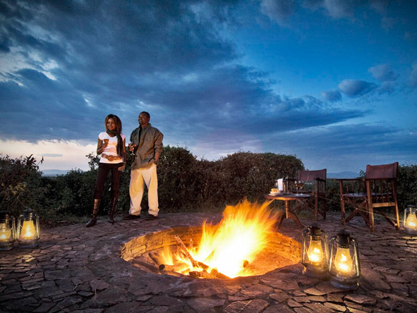 Kirawira Luxury Tented Camp - Camp fire drinks