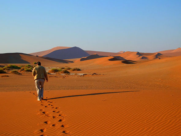 Walking the red dunes of Sossusvlei is part of the Namib Desert experience.