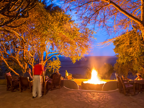 Mara Serena Safari Lodge - Welcoming boma fire