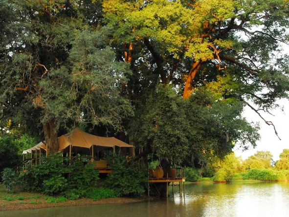 Kanga Bush Camp sits back from the river & overlooks a much frequented waterhole.
