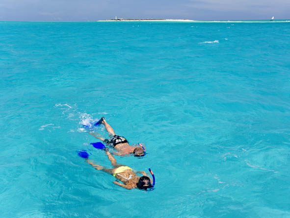 Sunny snorkelling in warm, safe water is part of the Quirimbas experience - ideal for families.