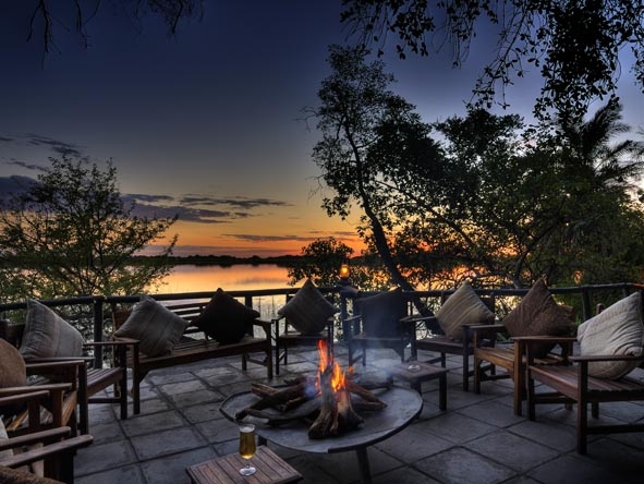 Early evening on safari is a time for tall drinks around the fire, accompanied by even taller stories!