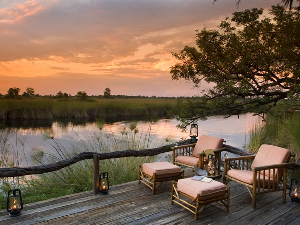 Raised viewing decks at our affordable riverside camps make the perfect spot for a sundowner drink.