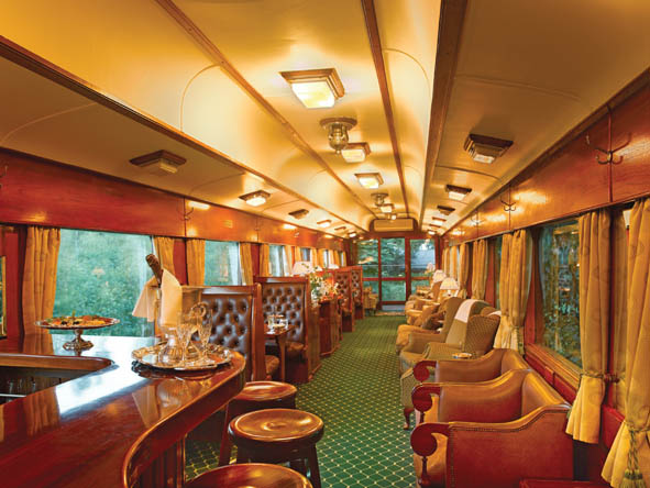 Champagne & canapes signal evening's arrival on board the peerless Rovos Rail.