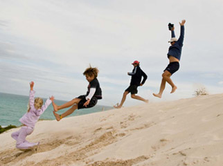 Easy Driver - Family jumping a dune at De Hoop