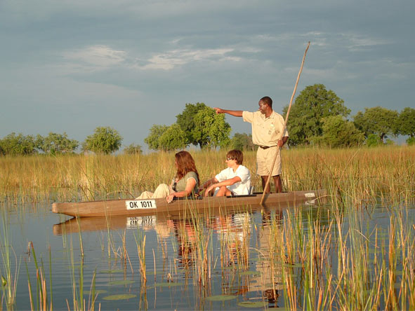 Exploring wild wetlands by canoe is part of the experience at Desert & Delta's Okavango camps.