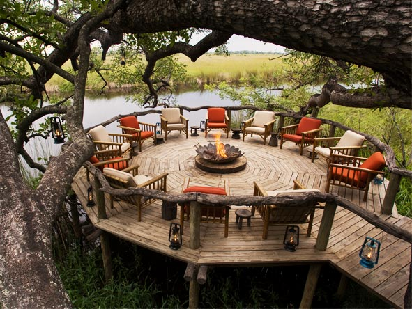 Swop safari stories around the campfire at Xakanaxa Camp, set in a game-rich area of the Moremi Game Reserve.