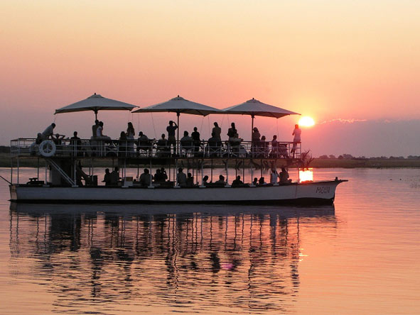 End the day with a Desert & Delta sunset cruise on the Chobe River - pure African magic.