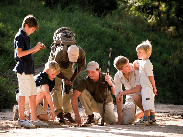 Children enjoy tailored activities & dedicated guides at Lion Sands' family-oriented camps.