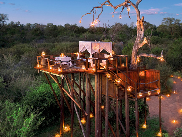 Candle-lit tree houses, set away from main camp, make for an unforgettably romantic night.