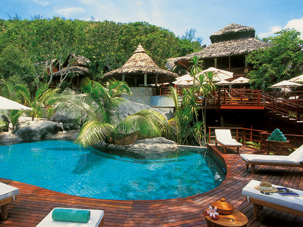 Lemuria in the Seychelles sits on a white-sand beach but you may prefer the cool shade of the resort's pool.