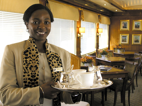 Start the day with a cup of fresh coffee, served with a famous Blue Train smile.