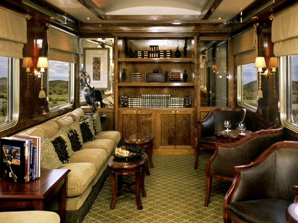 Polished hardwood furniture & the smell of leather create an old-world ambience aboard the Blue Train.