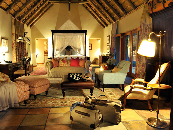 Draped four-poster beds & colonial antiques create a beguiling atmosphere at Sabi Sabi camps.