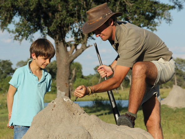 Game ranger teaching a boy