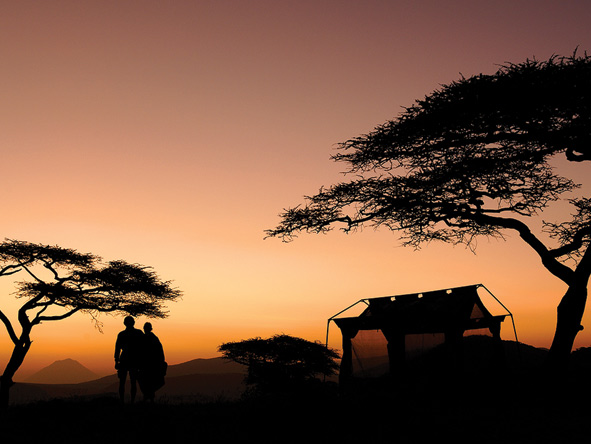 safari campsite at sunset