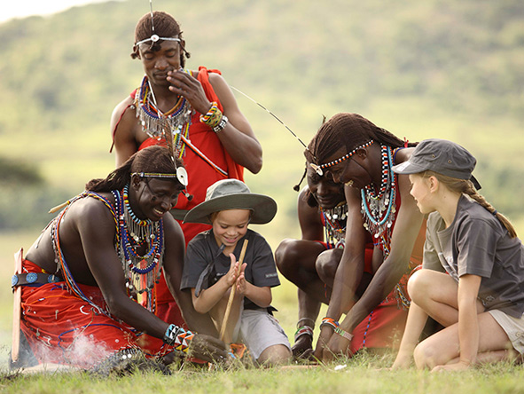 Masai warriors teach children to make a fire