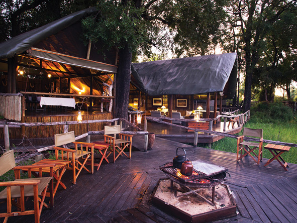 Outdoor dining area at Duba Plains Camp