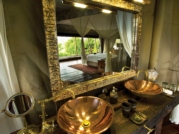 Zarafa Camp, luxury en-suite with copper details,