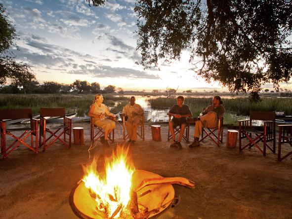 sitting around the campfire on safari