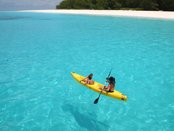 Canoe in crystal waters, Tanzania