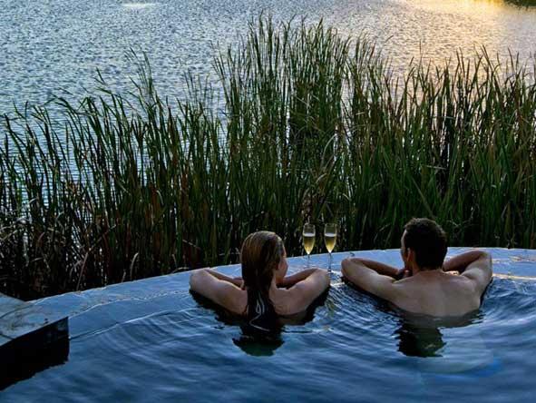 romantic sundowners in the pool at Kichaka