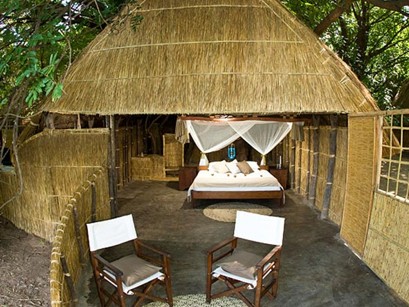 thatched chalet with private views
