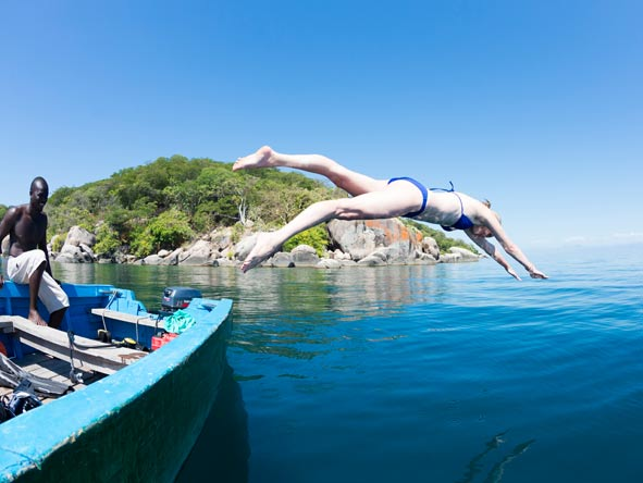 diving from a boat into lake malawi