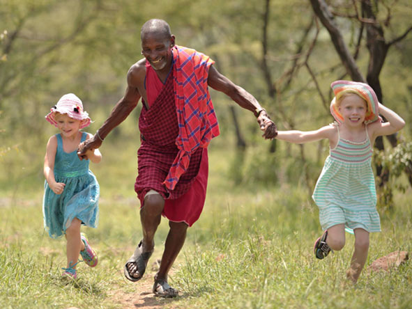 Children play with a Maasai local